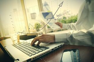 business documents on office table with smart phone and digital tablet and graph business diagram and man working in the background.jpeg